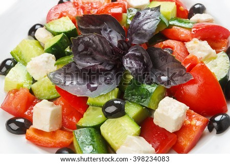 Restaurant healthy food, diet and vegetarian nutrition - greek vegetable salad with basil, closeup - stock photo