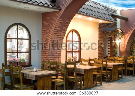 restaurant interior imitating places outside a european cafe or a bistro - stock photo