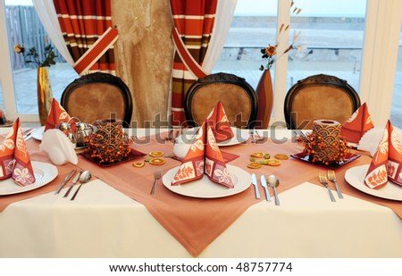 Restaurant interior with served table ready for guests and the party. - stock photo
