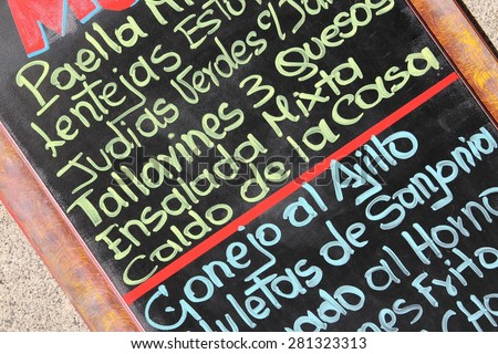 Restaurant menu with typical Spanish cuisine - outdoor bar in Madrid, Spain. Generic dish names. - stock photo
