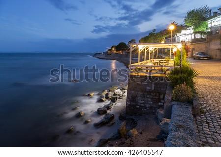 Restaurant on the beach at night - stock photo