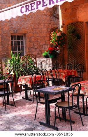 Restaurant patio in medieval town of Sarlat, France - stock photo