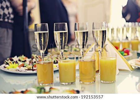 restaurant serving juice champagne glasses - stock photo