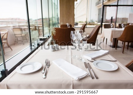 restaurant table setting by the window - stock photo