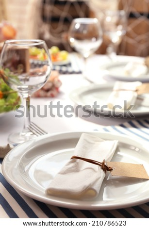 Restaurant table setting in sea theme - stock photo