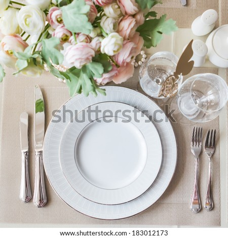 Restaurant table with empty glasses and plates - stock photo