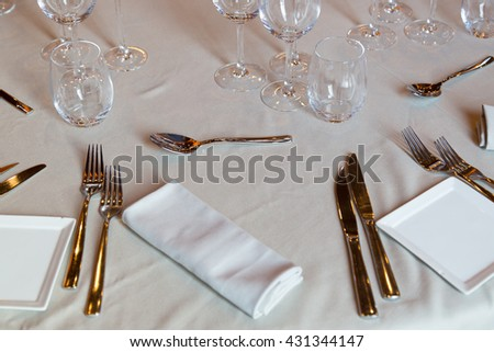 Restaurant with table settings for a dinner party - stock photo