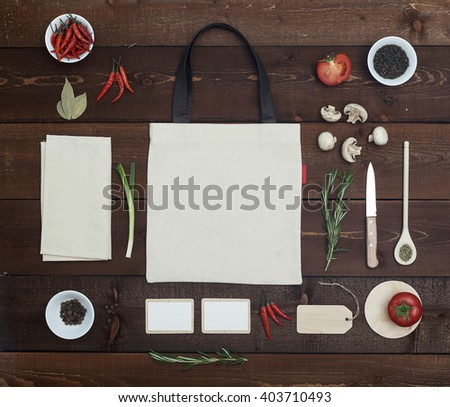 Restaurant wooden table with bag, business card and another utensil, top view - stock photo