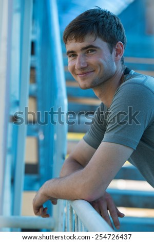 Resting athlete man tired after a long running sport event in the city - stock photo