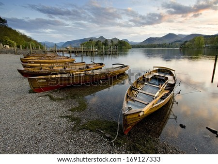 Resting Rowing Boats on Derwent Water at Keswick Landing Stage, Sunset - stock photo