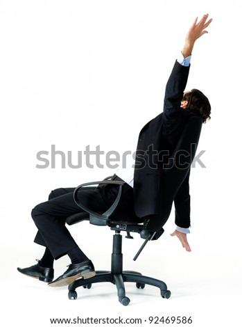 Restless office worker turns in his seat and throws his arms in the air - stock photo