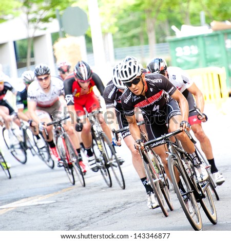 RESTON, VIRGINIA - JUNE 23: Cyclists compete in the Reston Town Center Grand Prix on June 23, 2013 in Reston, Virginia - stock photo