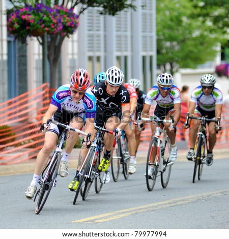 RESTON, VIRGINIA - JUNE 26: Cyclists compete in the Reston Town Center Grand Prix on June 26, 2011 in Reston, Virginia - stock photo