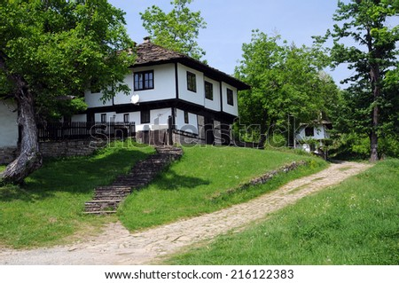 Restored white house and cobbled street in old Bozhentsi village in Bulgaria - stock photo