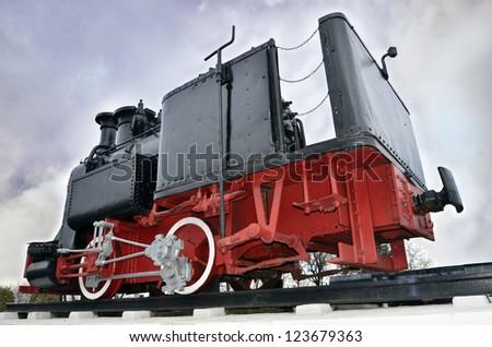 Restores steam engine on railway - stock photo