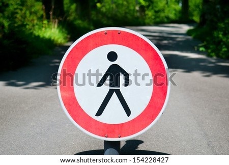 Restricted area. Pedestrians prohibited. No pedestrians. road sign - stock photo