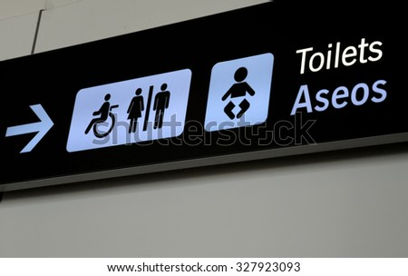 Restroom (toilet) real black sign at Barajas Airport, Madrid - stock photo