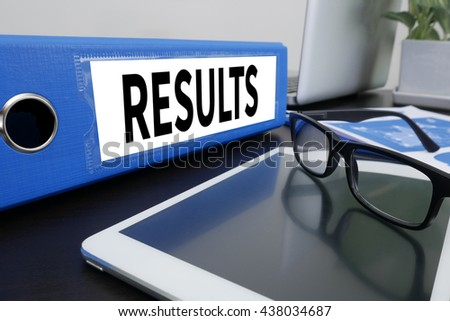 RESULTS  Office folder on Desktop on table with Office Supplies. ipad - stock photo