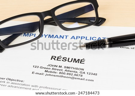 Resume with pen and glasses concept job applying - stock photo