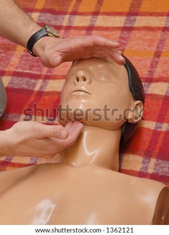 Resuscitation training on dummy - stock photo