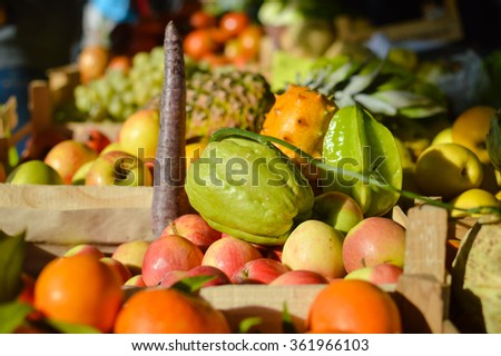 Retail business concept. Many different fruits on farmers market background.  - stock photo