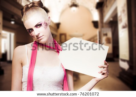 Retail Marketing And Sales Shopping Concept With A Woman Doll Holding Up A Price Tag Sign With Copyspace Inside A Shop Or Store - stock photo