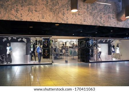 Retail shop entrance or exit. Facade of shop with display. Mannequin, dummy. - stock photo