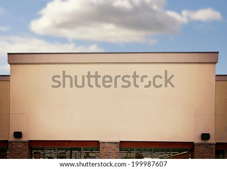 retail store front on a cloudy day - stock photo