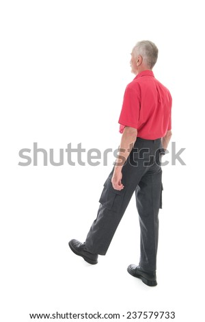 Retired man in red shirt walking away isolated over white background - stock photo