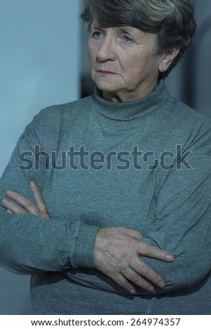Retired woman suffering for loneliness in residential home - stock photo