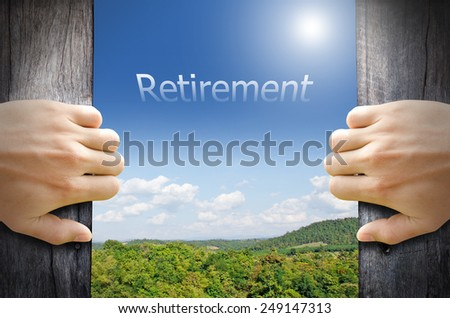 "Retirement concept. ""Retirement"" word floating in the sky while 2 hands opening a wooden door to the new world. - stock photo"