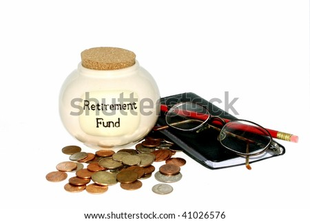 Retirement fund jar with checkbook and glasses - stock photo