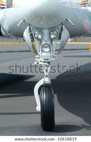 Retractable front landing gear of light, twin engine propeller aircraft. - stock photo