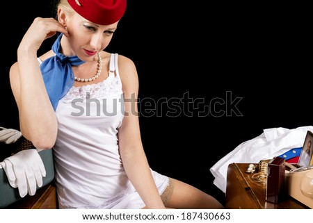 Retro Airline Stewardess or Flight Attendant in Lingerie. - stock photo