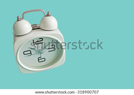 Retro alarm clock isolated on mint green background with copy space. Retro style. - stock photo