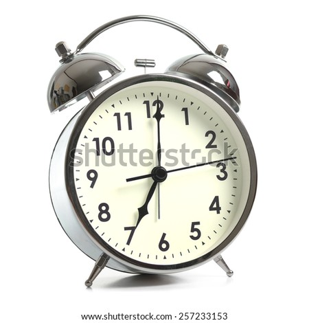 Retro alarm clock isolated on white background - stock photo
