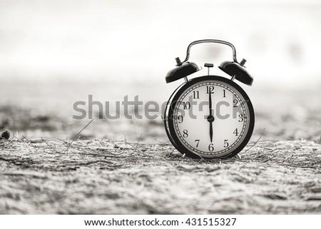 Retro alarm clock. Photo in retro color image style - stock photo