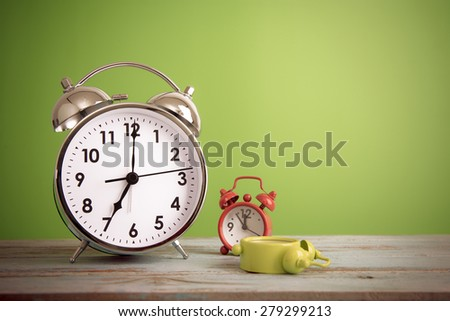 Retro alarm clock with retro colored - stock photo
