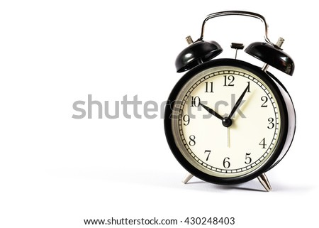 Retro alarm clock with Ten o'clock and five minute on white background . - stock photo