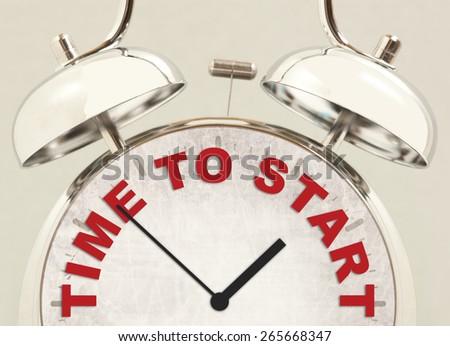 Retro alarm clock with text Time to start - stock photo