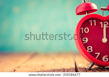 Retro alarm clock with  twelve o'clock,Start New Year - stock photo