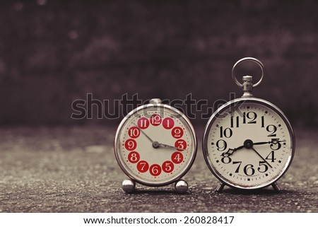 Retro alarm clock with vintage efect - stock photo