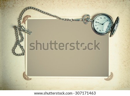 retro album page with vintage clock with chain. toned photo - stock photo