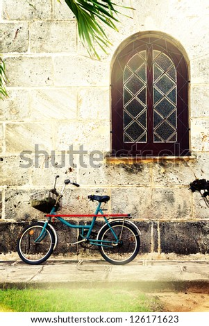 retro bicycle against old building wall in Cuba - stock photo