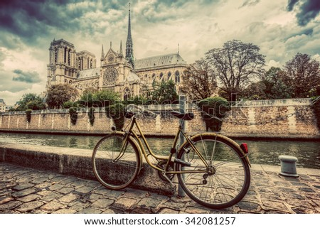 Retro bike next to Notre Dame Cathedral in Paris, France and the Seine river. Vintage - stock photo