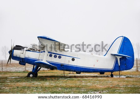 Retro biplane - stock photo