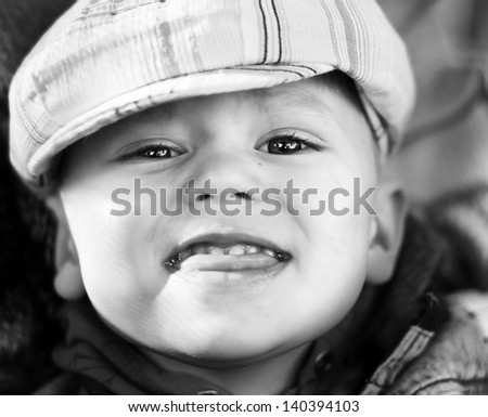 Retro black-and-white photo of funny  little boy in cap - stock photo
