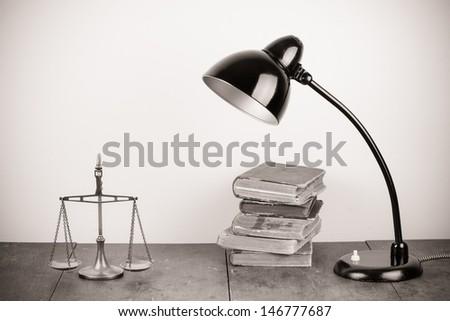 Retro black table lamp, scales and books sepia photo - stock photo