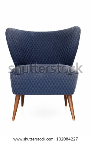 Retro blue upholstered comfy chair with patterned fabric and a curved back isolated on white - stock photo