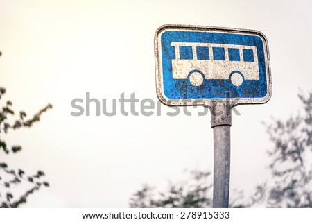 Retro bus stop sign in blue color - stock photo